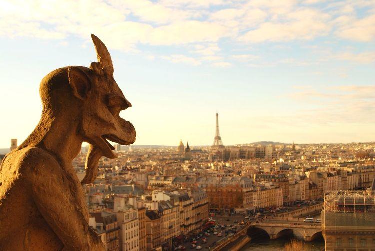 Gargoyle Of Notre-Dame De Paris Against Cityscape