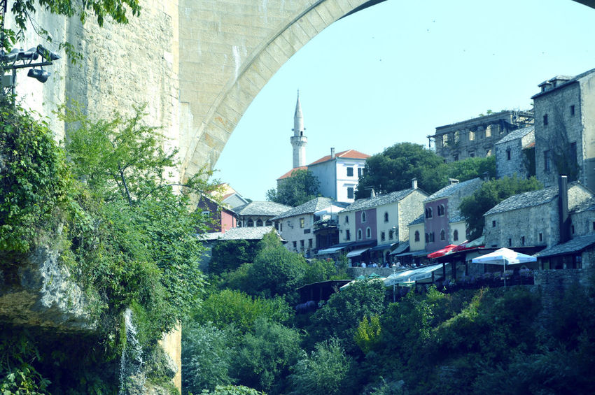 Travel to Europe under summer,Mostar in the Bosnia and Herzegovina BIH Bosnia And Herzegovina Mostar Summertime Travelling Architecture Background Beauty Beauty In Nature Bridge Day Europe Historical Nature Neretva No People Outdoors River Season  Spring Summer Travel Destinations Travelling Photography Tree Urban