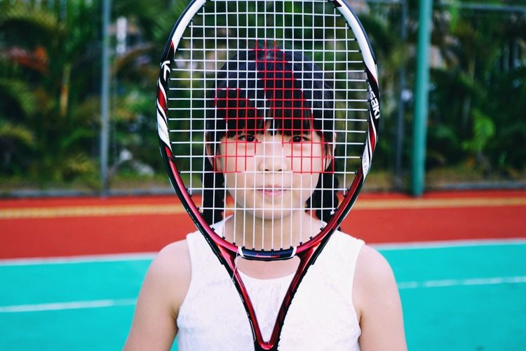 Sport Focus On Foreground One Person Red Tennis Outdoors Leisure Activity Real People Day Tennis Racket Front View Portrait Net - Sports Equipment Looking At Camera Lifestyles Court Tennis Ball Young Adult Close-up Tree