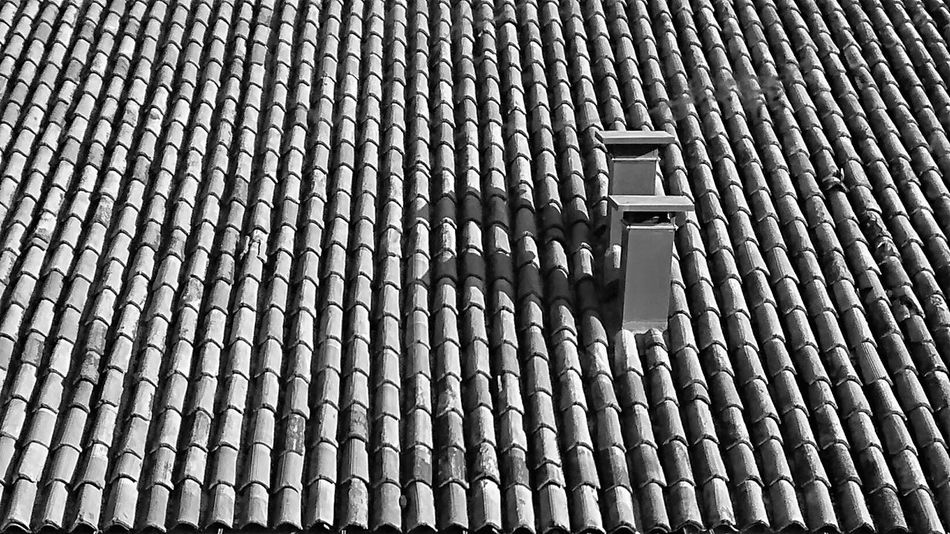 chimney on a tiled roof Arrangement Cimney Day Elevated View High Angle View No People Order Outdoors Roof Rooftop