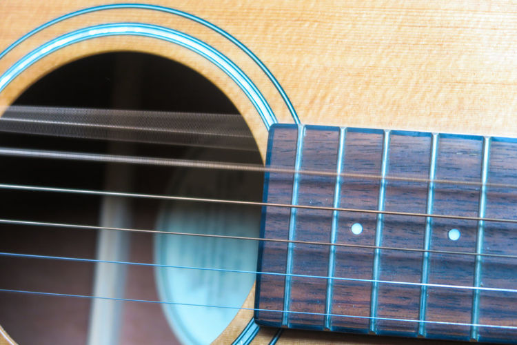 wavy string on an acoustic guitar Acoustic Guitar String Instrument String Waving Wavy Hair