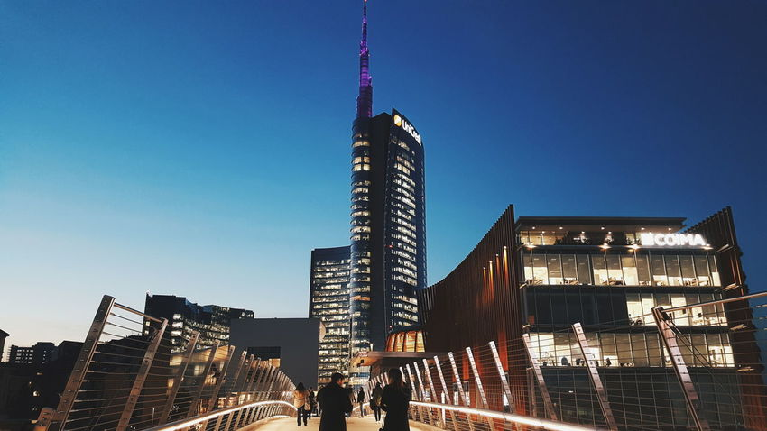 • big city lights • Milano Piazza Gae Aulenti Igers Hanging Out Taking Photos Milanodavedere Milanodavivere Illuminated Night Architecture Outdoors Modern Business Finance And Industry Low Angle View Skyscraper Sky Clear Sky City Cityscape