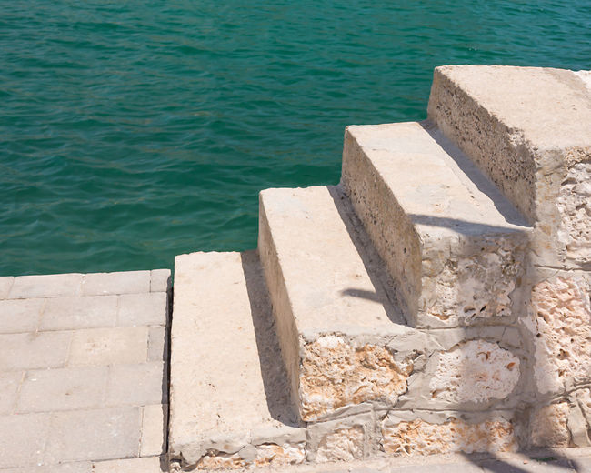 High angle view of built structure by lake