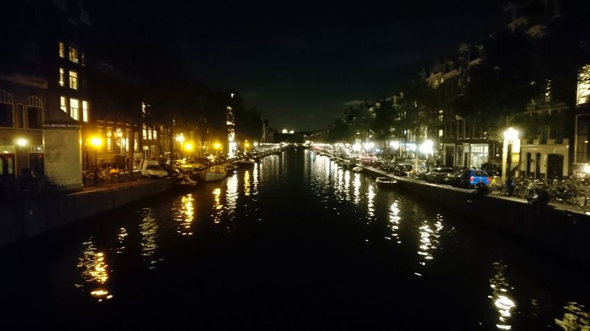 Down the canal. Amsterdam The Netherlands Netherlands Holland Canal Waterway Reflection Reflections Lights Symmetry Night Lights City Lights Dutch Night Pitch Black City Cityscape Water Illuminated Urban Skyline Nightlife Bridge - Man Made Structure Reflection Sky