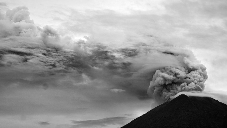 Eruption of Agung Volcano in Bali, Indonesia. The Photojournalist - 2018 EyeEm Awards Beauty In Nature Cloud - Sky Day Emitting Erupting Geology Land Mountain Mountain Peak Nature No People Non-urban Scene Outdoors Physical Geography Pollution Power Power In Nature Scenics - Nature Sign Sky Smoke - Physical Structure Volcanic Crater Volcano Warning Sign
