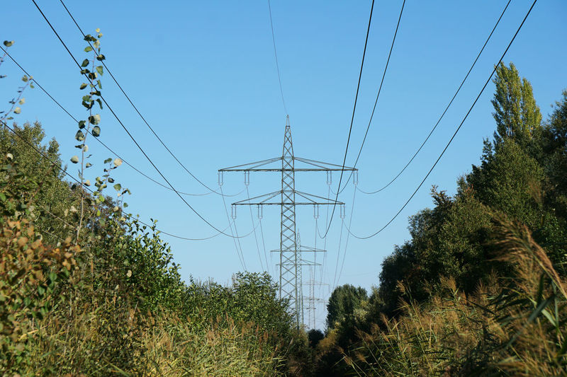 Green Energy Power Pylon Transmission Line Cable Clear Sky Electricity  Electricity Pylon Energy High-tension Line High-voltage Low Angle View Nature No People Overhead Power Line  Power Supply Technology