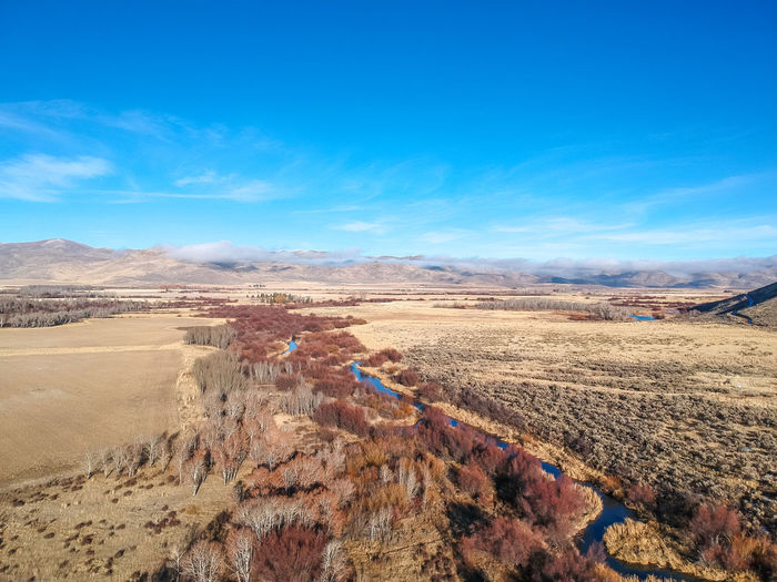 High perspective over Silver Creek in Bellevue, Idaho, (between Sun Valley and Twin Falls, Idaho). Bellevue Drone  Drone Shot Idahome Beauty In Nature Blue Sky Dji Dji Spark Drone Photography Dronephotography Droneshot Go Higher High Angle View Idaho Idahoexplored Idahogram Landscape River Scenics - Nature Sky Spark Tranquil Scene West