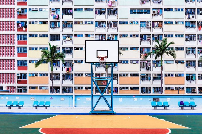 Basketball Court Against Buildings In City