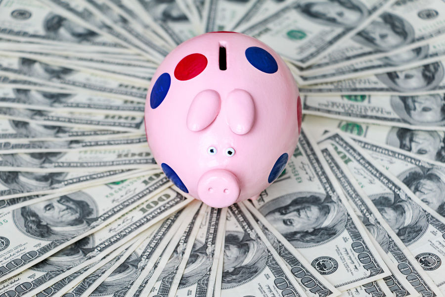 piggy bank is on dollar bills Tax New Life Grouth Profit Currency Rich Salary USD Bank Banknote Cash Currency Dollar Dollars Finance Home Finances Indoors  Investment Making Money Money No People Paper Currency Piggy Piggy Bank Pink Color Profit Retirement Savings Wealth