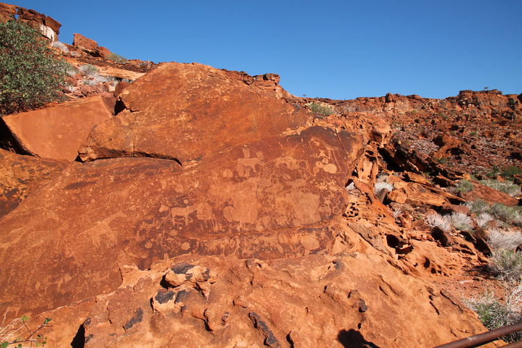 Rock formation on land against clear sky