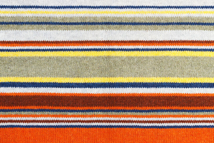 Closeup of colored knitted wool texture. Fabric multicolor background Textile Pattern Striped Multi Colored Backgrounds Full Frame Textured  Close-up Woven Material Rug Clothing Cotton Blanket No People Wool Indoors  Man Made Man Made Object Textured Effect