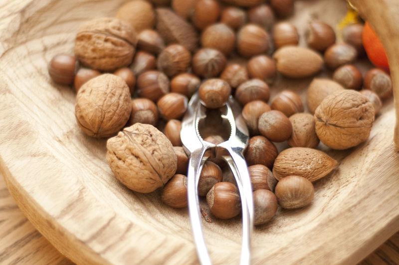 Close-up of walnuts and hazelnuts on table
