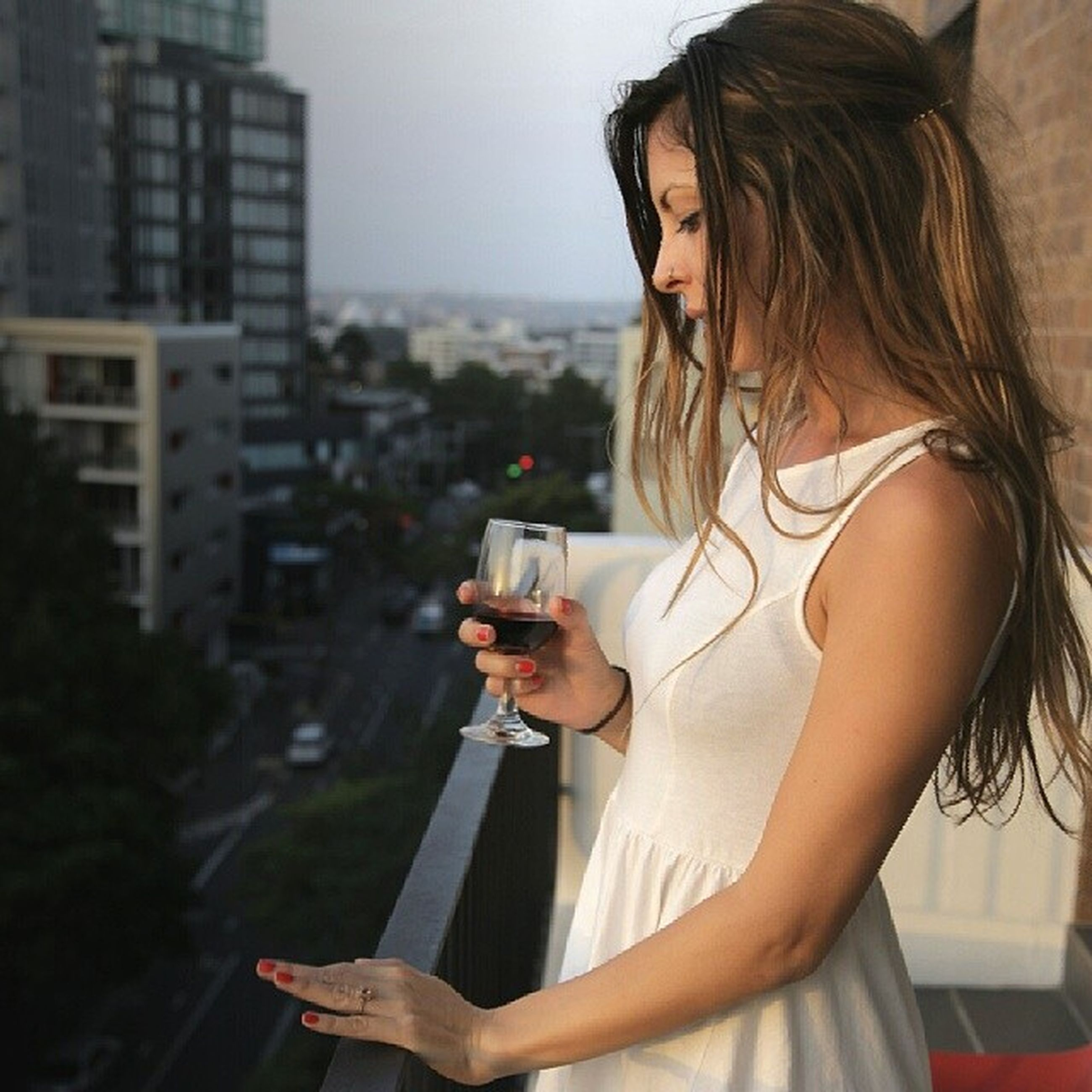 young adult, holding, lifestyles, person, wireless technology, focus on foreground, leisure activity, young women, technology, smart phone, communication, headshot, casual clothing, mobile phone, photography themes, waist up, indoors
