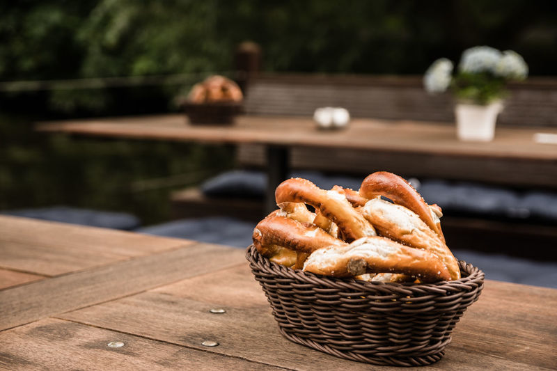 Bakery Bread Bread Basket Close-up Day Focus On Foreground Food Freshness Natural No People Outdoors Pretzel Bread Salted Bread Table Table Setting Woody With Bread