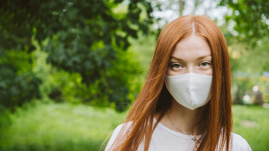 New normal, coronavirus covid-19 second wave. portrait of redhead woman with mask