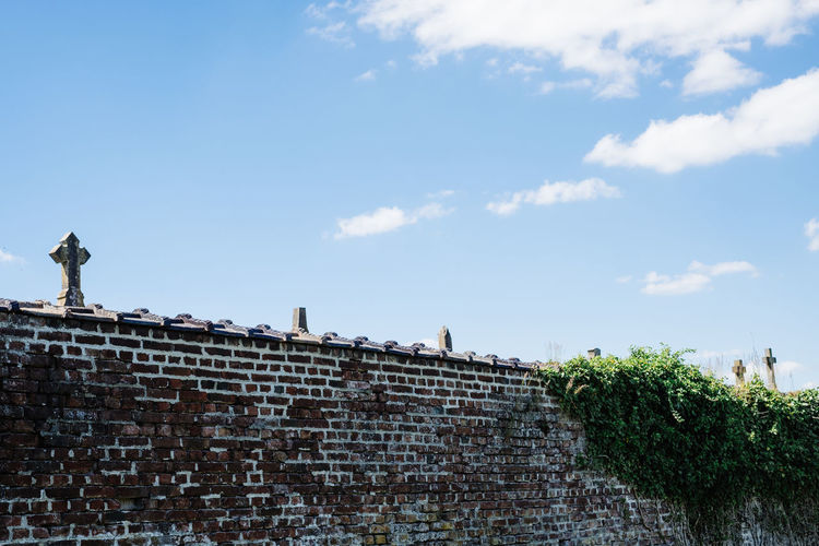 Brick Wall Cemetery Cross Grave Sunlight Behind Cloud - Sky Graveyard