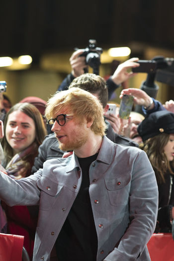 Berlin, Germany - February 23, 2018: Ed Sheeran poses for a selfie with a fan while attending the 'Songwriter' premiere during the 68th Berlinale International Film Festival Berlin 2018 Artist Celebrity Ed Sheeran Ed Sheeran <3 Ed Sheraan❤ Famous Singer  Singer/Song Writer Audience Berlinale Berlinale 2018 Berlinale Festival Berlinale2018 Berlinale68 Celebrities Crowd Famous People Fans Group Of People People Portrait Real People Singer And Artist Song Writer Stage