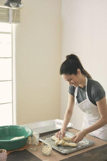 Woman preparing food at table