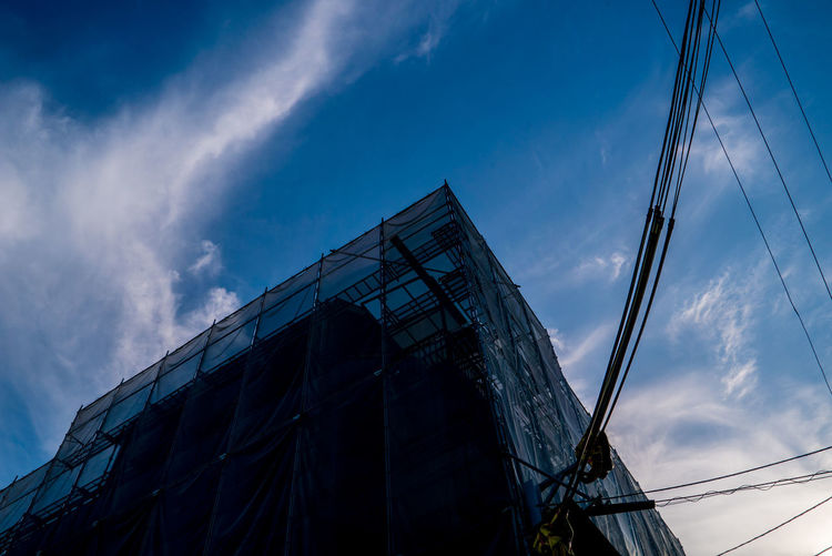 EyeEmNewHere Sky And Clouds Sky Collection Architecture Blue Building Building Exterior Built Structure Cloud - Sky Construction Industry Construction Site Day Incomplete Industry Low Angle View Metal Nature Nautical Vessel No People Outdoors Scaffolding Sky Sky_collection Skyscraper Street Streetphotography The Street Photographer - 2018 EyeEm Awards