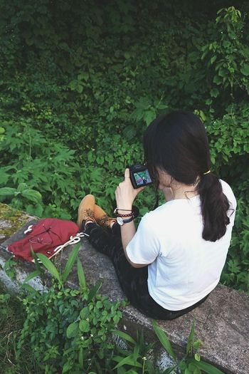 High Angle View Outdoors Green Color Sitting Nature Relaxation One Girl Only Leaf Green Nature Green Leaves Sonyphotography Fossil Watch Fossilwatch Yellowboots Timberland Timberland Boots