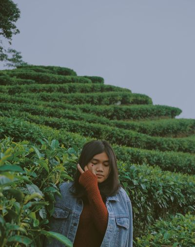 One Person Plant Real People Growth Green Color Field Land Young Women Rural Scene Beauty In Nature Agriculture Front View Young Adult Landscape Crop  Nature Casual Clothing Outdoors Lifestyles Sky