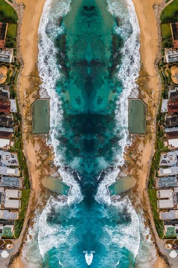 High angle view of sea by buildings