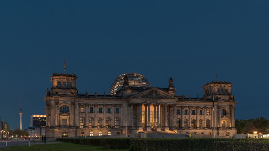 View of reichstag building against blue sky
