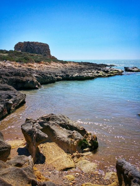 Low Tide Revelations Punta Braccetto Ragusa Sicily Italy Travel Photography Travel Voyage Traveling Mobile Photography Fine Art Scenic Landscapes Backlight Nature Shorelines Rocks Sea Waves Architecture Watch Towers Reflections And Shadows Mobile Editing The Great Outdoors With Adobe