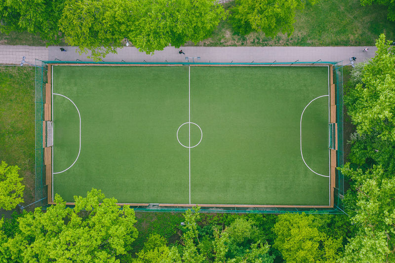 Aerial view of soccer field amidst trees