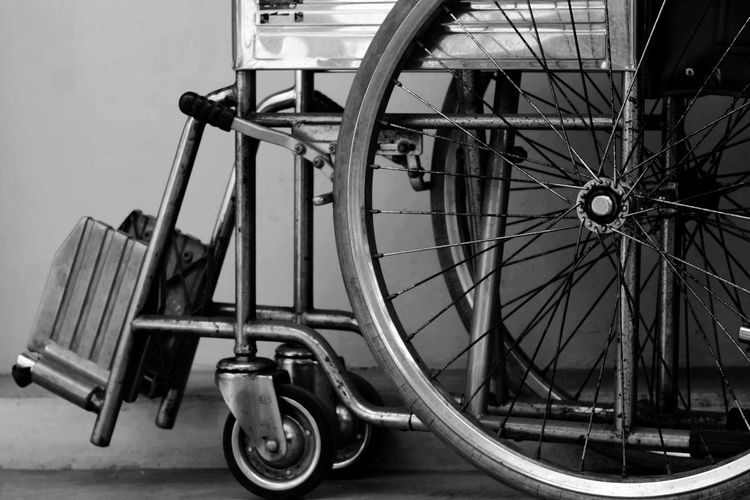 Close up wheel of wheelchair in hospital Help Insurance Wheelchair Mobility Hospital Disabled Disability  Patient Disease Sick Health Healthy Healthcare Medical Cure Care Weakness Emergency Accident Wellness Illness Clinical Physiotherapy Diagnostic Injury