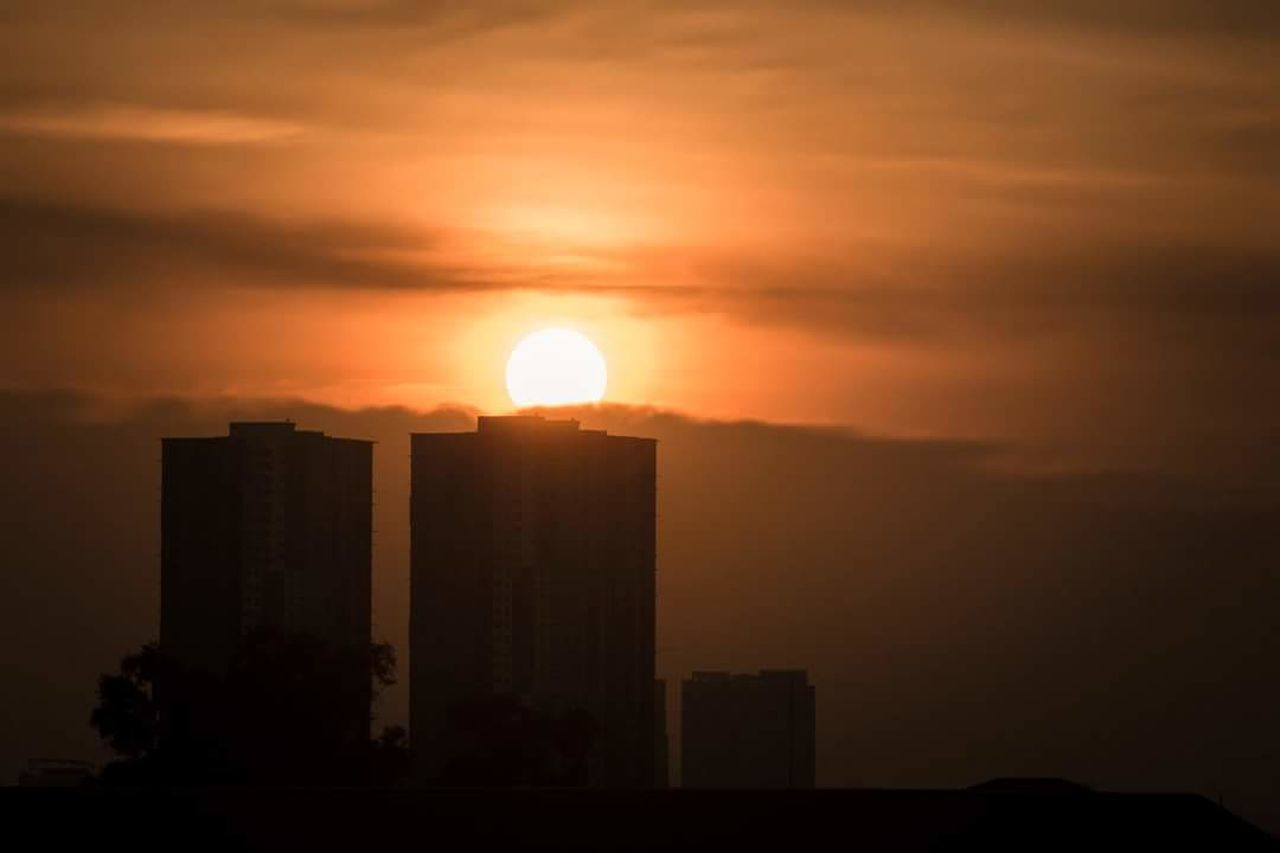sunset, sun, architecture, built structure, building exterior, orange color, skyscraper, silhouette, no people, city, sky, travel destinations, outdoors, cityscape, tall, beauty in nature, nature, day