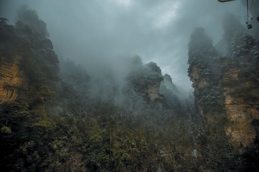 Unbelievable view, a must visit in your life. How wonder this beautiful place! Go Higher Color Your Horizon EyeEmNewHere EyeEmBestPics EyeEm Nature Lover Eyeyem Travel Collection EyeEm Best Shots Check This Out China Zhangjiajie China Travelling ZhangjiajieNationalPark Zhangjiajie Geopark Zhangjiajie Fog Nature Beauty In Nature Mountain Mist Landscape Outdoors Day No People Scenics Sky Tree Hazy  Go Higher