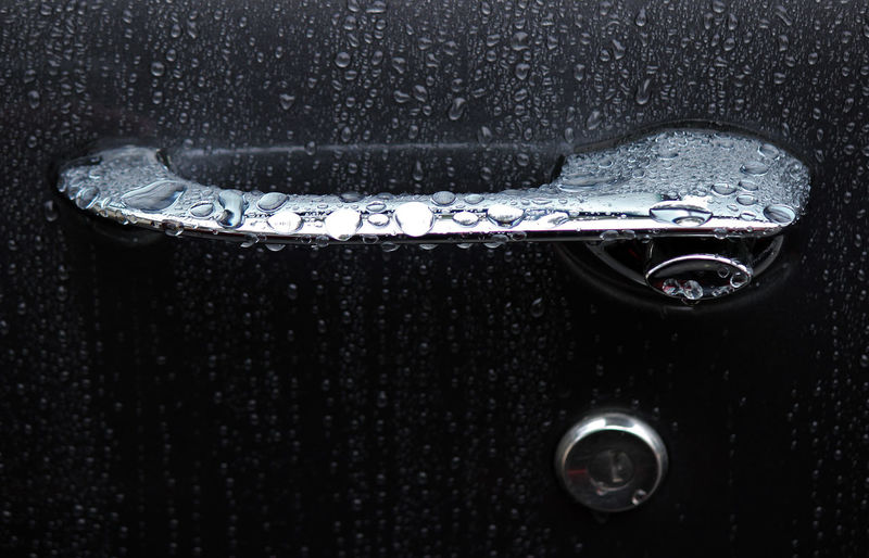 Full Frame Shot Of Wet Car Door Handle During Rain