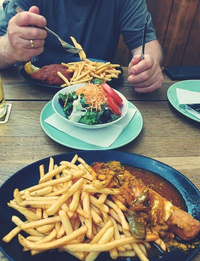 Man eating food on table