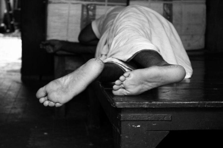 Man sleeping on wooden table