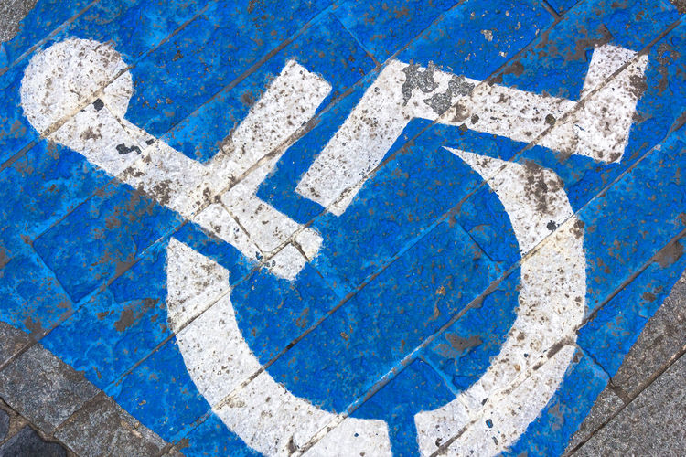 Grungy tone of sign disabled Access Asphalt Background Blue Care Disability  Disabled Grunge Handicap Handicapped Icon Medical Paint Parking People Permit Reserved Road Sign Space Street Symbol Traffic Transport Transportation