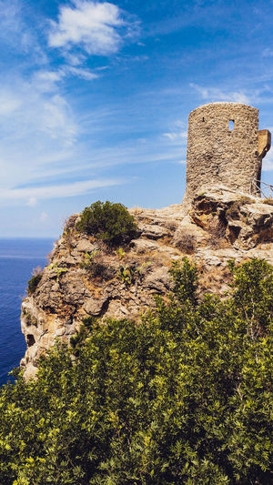 Watchtower Beauty In Nature Great Outdoors Cliff Rocky Coastline Landscape Sightseeing SPAIN Balearic Islands Majorca Tower Watchtower Sea Mediterranean  Stone Tower Water Sky Close-up Historic Old Ruin Horizon Over Water Ruined Coast Ocean Rock Calm The Past Archaeology Shore Civilization