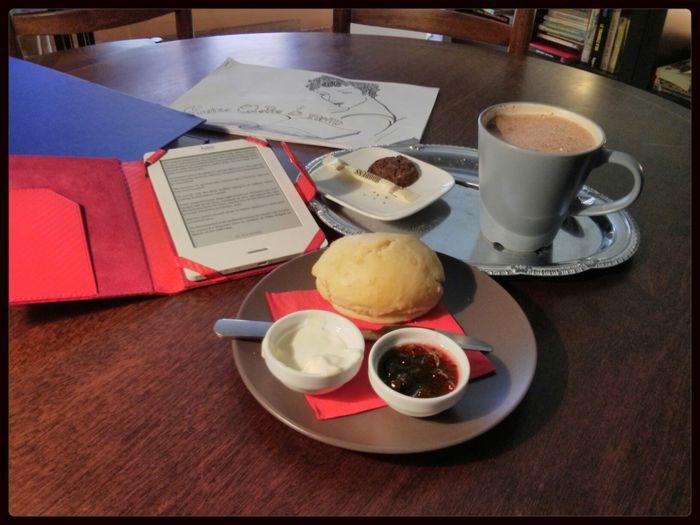 Post last exam Indulgence : hot Chocolate Milk, scone and book.
