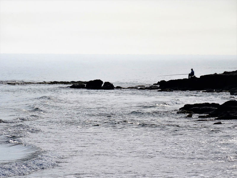 Beauty In Nature Black & White Fisherman Fishing Horizon Over Water Lone Figure Lonely Peace And Quiet Rock - Object Scenics Sea Serenity Tranquility
