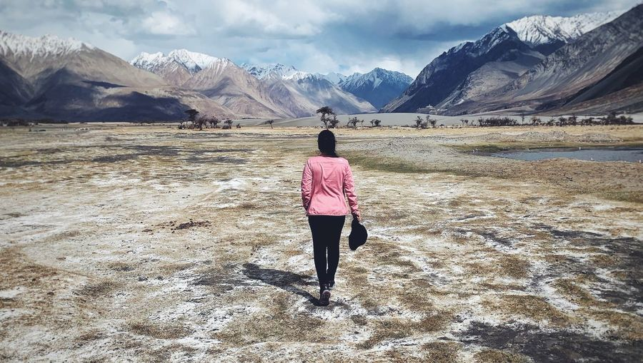keep walking Asian  North Face Exploring Himalayas India Woman In Nature Sand Dune Leh Ladakh Wanderlust Keep Walking Real People Mountain Rear View One Person Beauty In Nature Sky Full Length Mountain Range Lifestyles Cloud - Sky Landscape Scenics - Nature