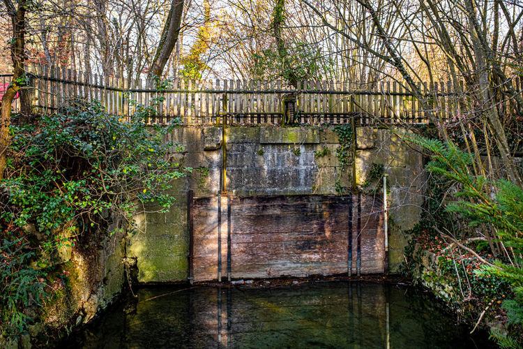View of old wooden bridge in canal