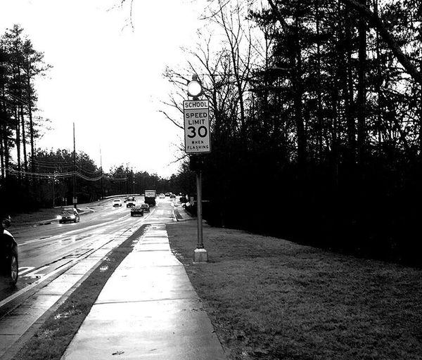 School Slow Rainy Days Right Lane Must Turn Right Blackandwhite Photography Black And White Crosswalk Pineapple🍍 The Photojournalist - 2016 EyeEm Awards The Portraitist - 2016 EyeEm Awards
