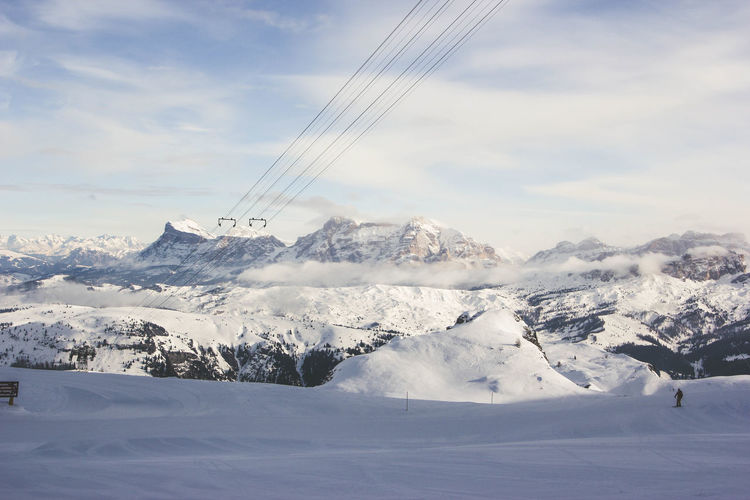 Captured while skiing in the beautiful alps. Alpine Dolomites, Italy Hiking Skiing Alps Beauty In Nature Cable Cold Temperature Day Landscape Mountain Nature No People Outdoors Scenics Sky Snow Travel Destinations Winter
