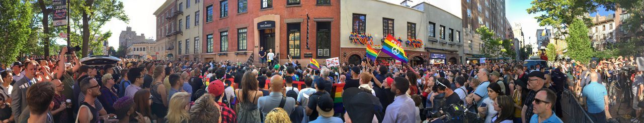 Greenwich Village, NYC, June 13, 2016: LGBT rights advocates gather at a vigil at the historic Stonewall Inn, in Greenwich Village, Manhattan, to honor the victims of the mass shooting at a gay club in Orlando, Florida. Casual Clothing City City Life Civil Rights  Crowd Day Gay Greenwich Village Gun Control Large Group Of People Leisure Activity Lgbt Lifestyles Manhattan Mixed Age Range Multi Colored New York City NYC Orlando Shooting Outdoors Protest Stonewall Inn Vigil