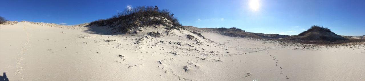 Panoramic scenic view of sand dunes