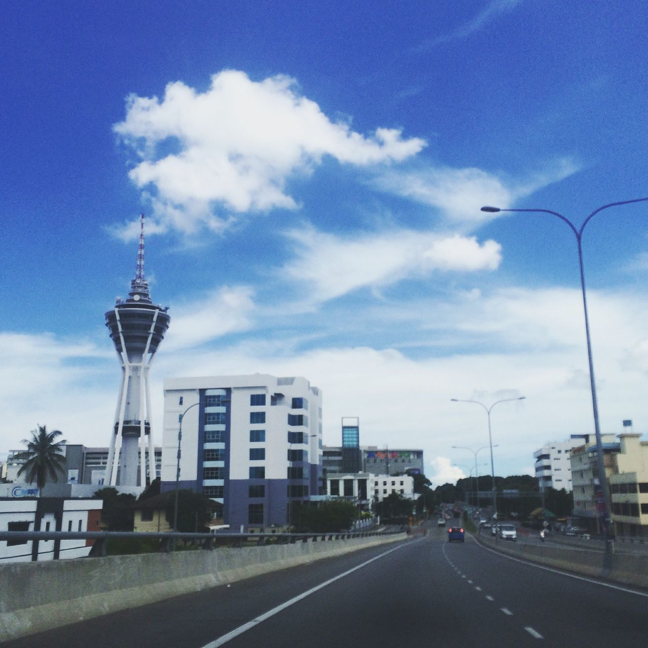 architecture, road, built structure, sky, cloud - sky, transportation, day, building exterior, outdoors, city, no people