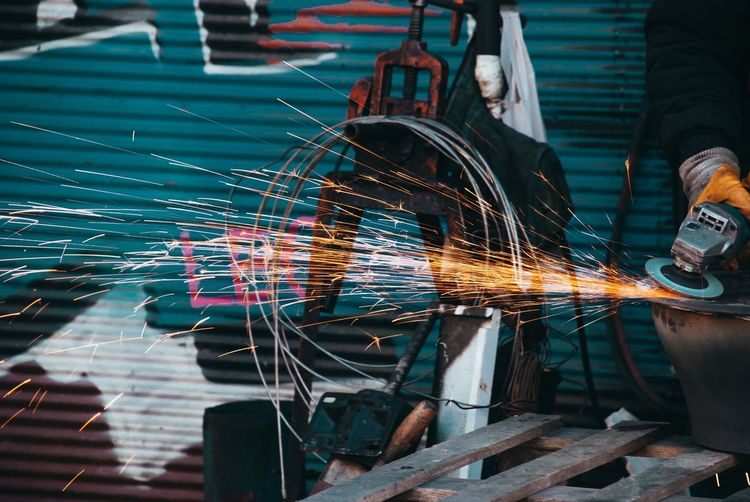 Close-up of metal being welded in factory