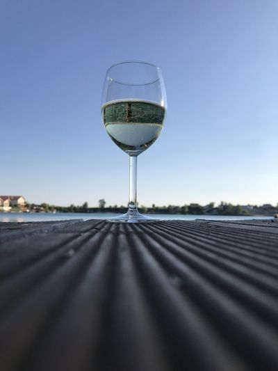 Close-up of beer glass against clear sky