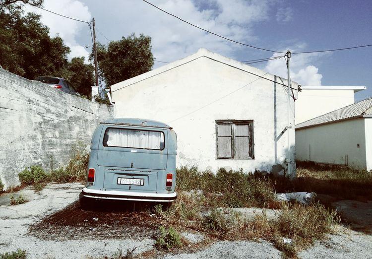 Vintage car on road against sky
