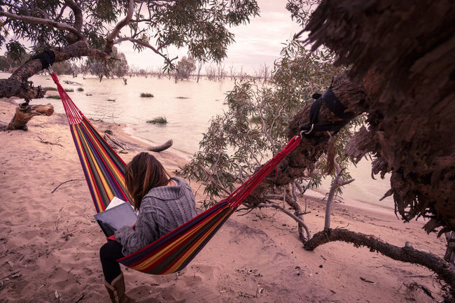 digital nomad in action Digital Nomad Laptop Office Hammock Lake Australia Writing Working One Woman Only Remote Office Virtual Office Travel One Woman Travel Destinations Nautical Vessel Nature One Person Adult